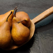 Kaiser pears over wood spoon — Stock Photo #16396937