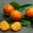 Fresh clementines over ardesia — Foto Stock