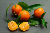 Fresh clementines over ardesia — Stock Photo