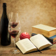 Relaxing moments with novel nooks and pair of wine glass — Stock Photo #19146723
