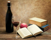Wine glass and old novel books — Stok fotoğraf