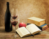 Relaxing moments with novel nooks and pair of wine glass — Stock Photo