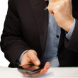 Businessman reading sms on the phone — Stockfoto
