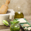 Pesto sauce with ingredients and kitchen utensils — Stock Photo