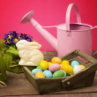 White chocolate bunny in easter setting — Stock Photo