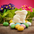 White chocolate bunny over easter eggs — Stock Photo