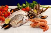Raw fish and mollusk selection — Stock Photo