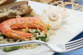 Risotto with asparagus, razor shell and prawn — Stock Photo