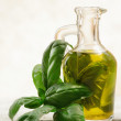 Olive oil flavored with basil — Stock Photo