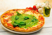 Pizza with pesto — Stock Photo