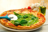 Pizza with pesto sauce — Stock Photo
