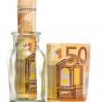 Savings inside glass jar — Stock Photo