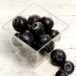 Stock Photo: Blueberries inside glass jar