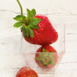 Fresh strawberry inside glass jar — Photo