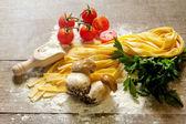 Genuine ingredients for tagliatelle alla boscaiola — Stock Photo