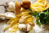 Raw tagliatelle with boletus and parsley — Stock Photo