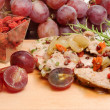 Pork fillet with red grapes and goji berries — Stock Photo