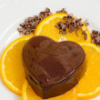 Dessert with chocolate pudding and ornage slices — Stok Fotoğraf #34711445