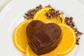 Dessert with chocolate pudding and ornage slices — Stockfoto