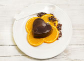 Dessert with chocolate pudding and orange slices — Stock Photo