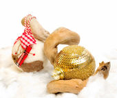 Christmas baubles in winter scene — Stock Photo