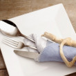 Silverware over ceramic plate — Stock Photo