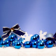 Blue christmas against blue background — Stock Photo