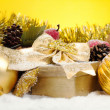Christmas package with golden decorations — Stock Photo