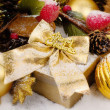 Christmas box with golden decorations — Stock Photo