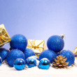 Blue christmas with golden pinecone — Stock Photo