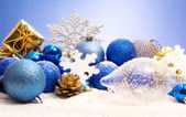 Christmas decorations with pinecones and snowflake — Stock Photo