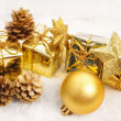 Golden christmas packaging and pinecone — Stock Photo