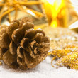 Golden pinecone against christmas background — Stock Photo