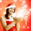 Female santa claus with sparkling stras — Stock Photo