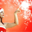 Christmas girl indicates sparkling stars — Stock Photo