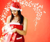 Beautiful girl dressed santa claus opend christmas gift — Zdjęcie stockowe