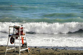 Lifeguard in front of rough sea — Stock Photo