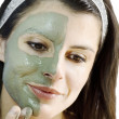 Stock Photo: Clay mask beauty treatment