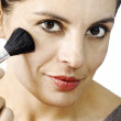 Stock Photo: Beautiful woman making up