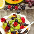 Stock Photo: Greedy fruit salad with red fruits