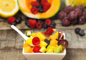 Delicious fruit salad with red fruits in a  bowl — Stock Photo