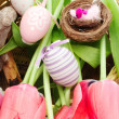 Stock Photo: Easter composizition with decorative bird and eggs