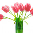 Stock Photo: Pink tulips inside glass vase