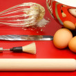 Stock Photo: Confectioner utensils with eggs and mixture