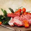 Stock Photo: Raw meat selection with pink pepper and herbs