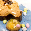 Stock Photo: Dove with easter chocolates-colombpasquale