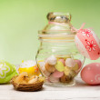 Stock Photo: Easter bonbons over green background