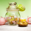Stock Photo: Easter little eggs inside vintage glass jar