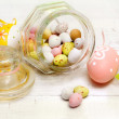 Stock Photo: Easter bonbons over rough white wood