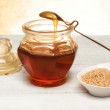 Stock Photo: Honey inside vintage jar